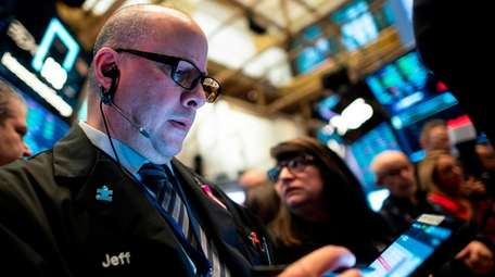 Traders get to work after the opening bell