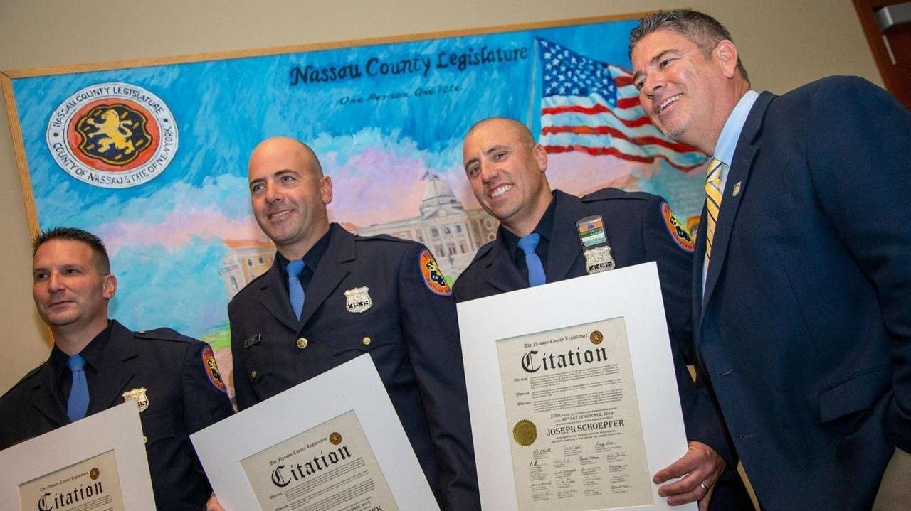 Three Nassau County police officers were honored Monday