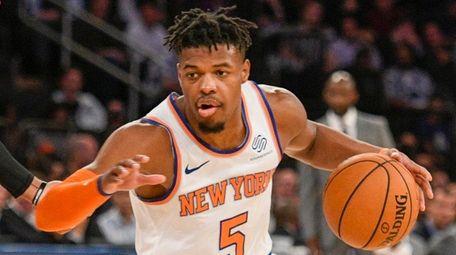 Knicks guard Dennis Smith Jr. drives against Hawks