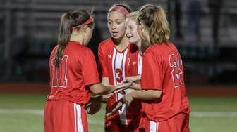 Connetqouot's Kayla Valerioti #11 is congratulated by teammates