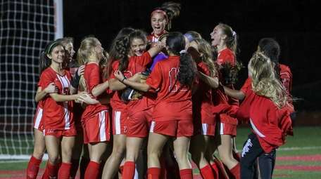 Connetquot players surround goalie Nicolette Pasquarella after they