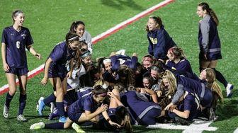 Massapequa celebrates their overtime win over Oceanside at