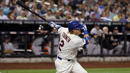 Justin Turner follows through on a first inning