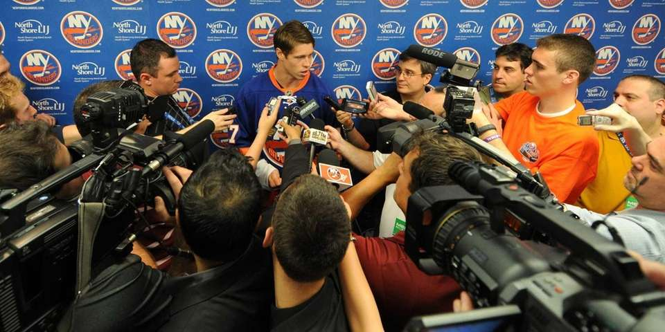 Islanders left winger #17 Matt Martin speaks to