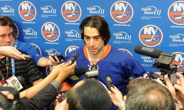 Matt Moulson speaks to media gathered inside Nassau