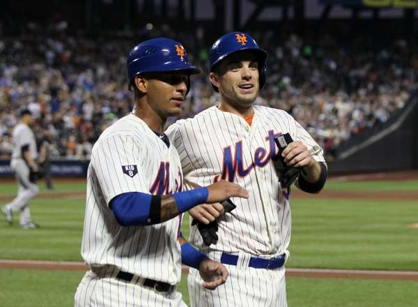 David Wright, right, and Ronny Cedeno celebrate after