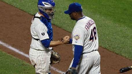 Frank Francisco #48 and Josh Thole #30 of