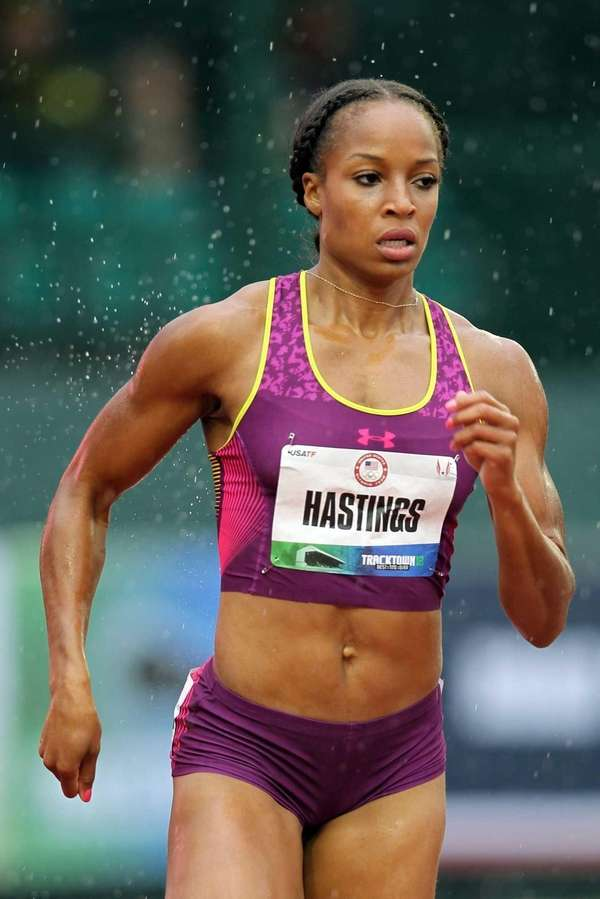 Natasha Hastings competes in the opening round of
