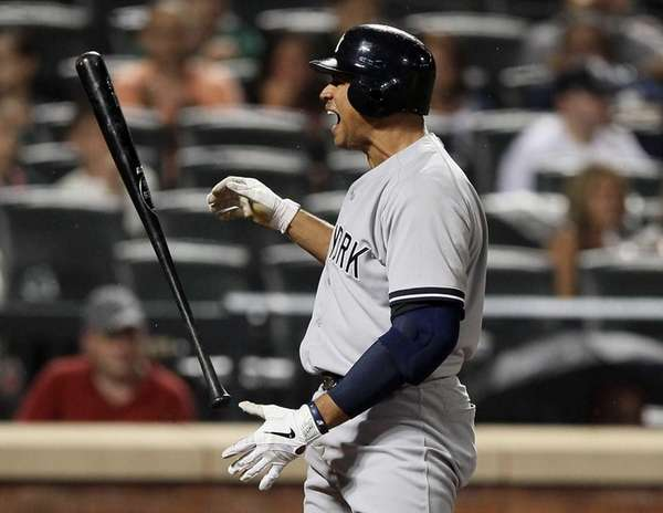 Alex Rodriguez reacts after he striking out in