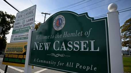 A sign welcomes visitors to New Cassel.