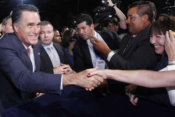Republican presidential candidate Mitt Romney, greets attendees at