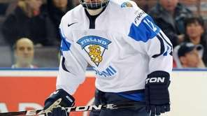 Ville Pokka of Team Finland skates during the