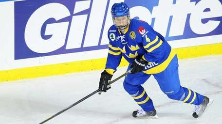 Calle Andersson of Sweden skates with the puck