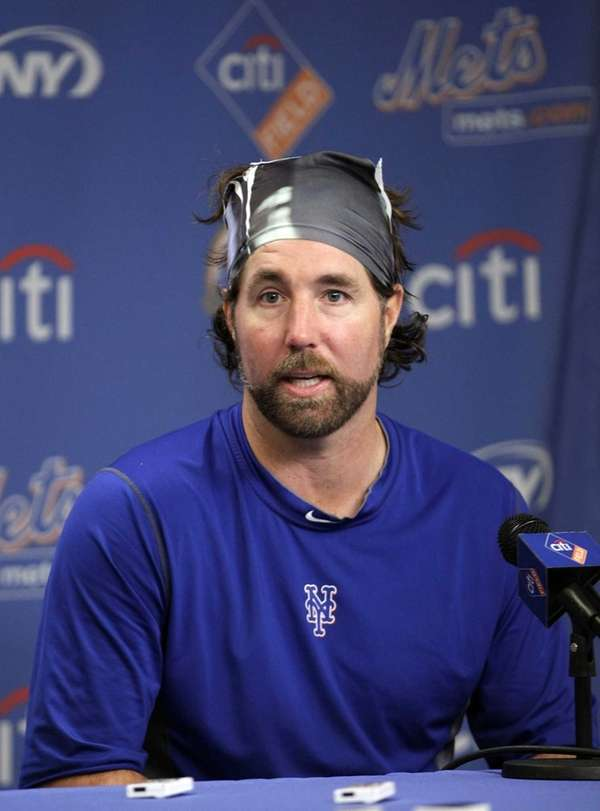 Mets pitcher R.A. Dickey responds to questions during