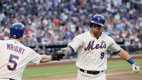 Kirk Nieuwenhuis is congratulated after he hit a