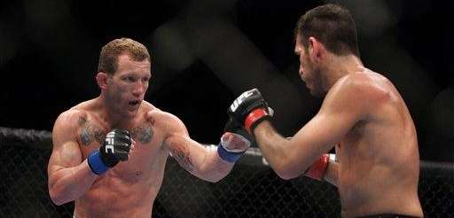 Gray Maynard, left, in action against Kenny Florian