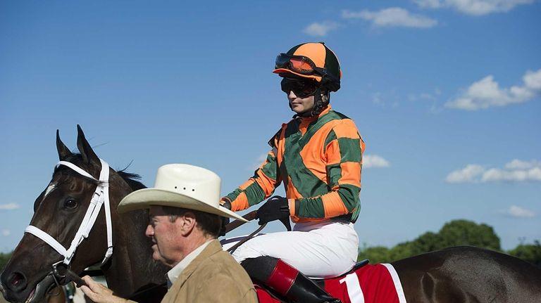 Jockey Rosie Napravnik escorted out to the track
