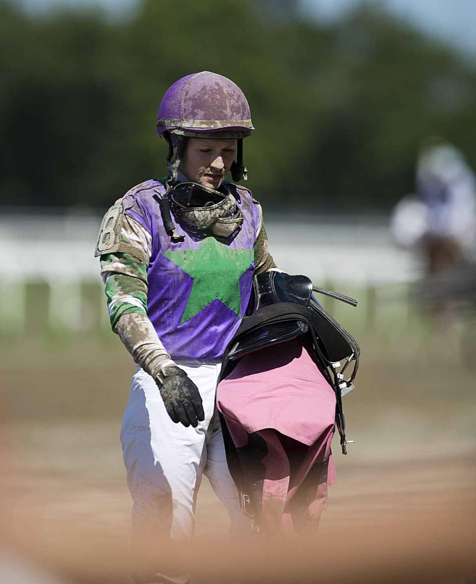 Jockey Rosie Napravnik leaving the track after the