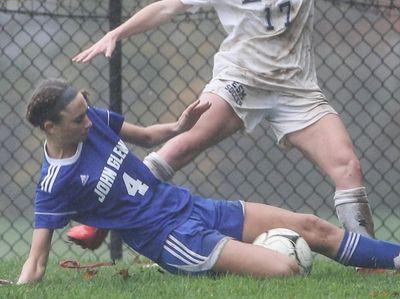 Mackenzie Stickelman of Glenn gets the ball away