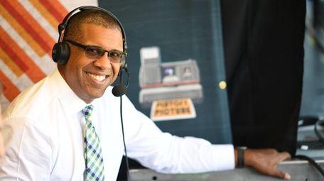 ESPN baseball analyst Eduardo Perez looks on during