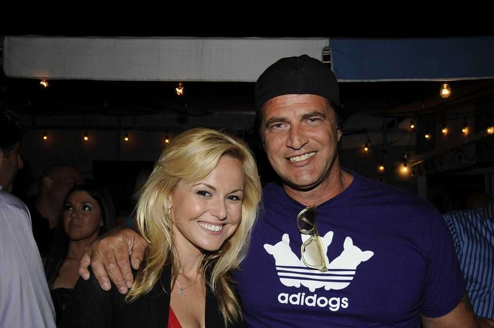 Actor John Enos and smiling fan hang out