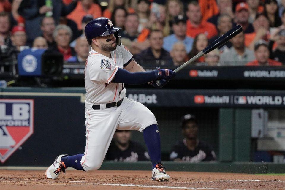 Houston Astros' Jose Altuve hits a sacrifice fly