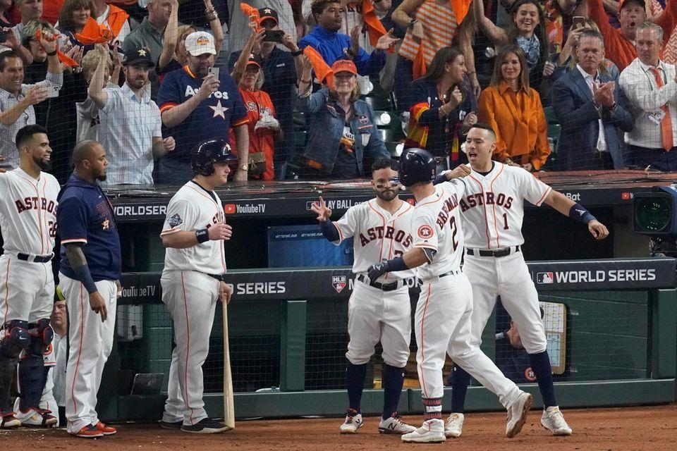 Houston Astros' Alex Bregman (2) celebrates after his