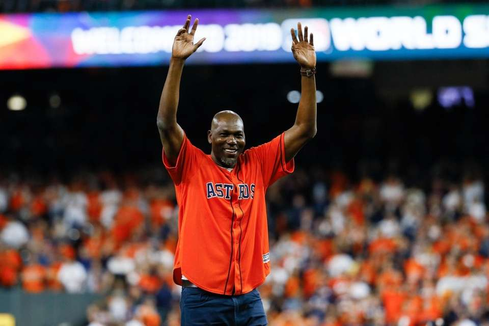 Hakeem Olajuwon throws a ceremonial first pitch before