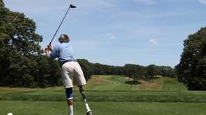 John Prestwood of Berwyn, PA balances after teeing