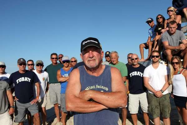 Former Tobay Beach Lifeguard Captain Gary Mims poses