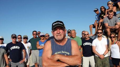 Former Tobay Beach Lifeguard Captain Gary Mims poses