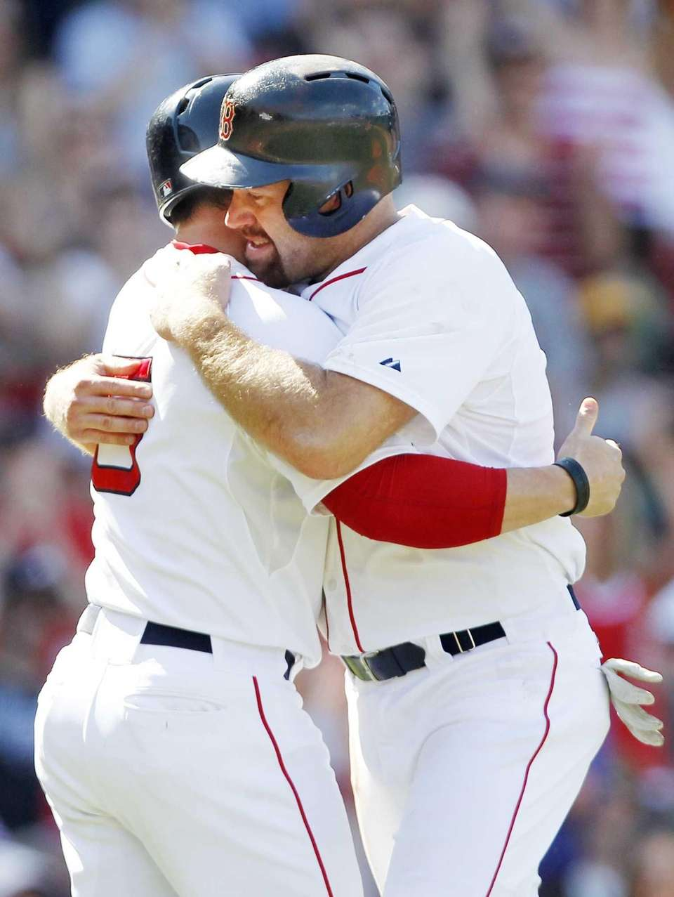 Boston Red Sox's Kevin Youkilis, right, gets a