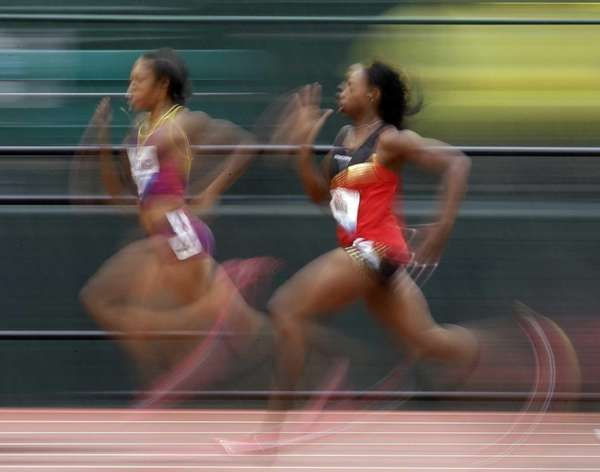 Natasha Hastings, left, and Keshia Baker compete in