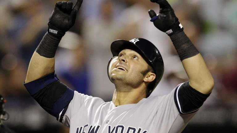 New York Yankees' Nick Swisher reacts at the