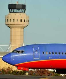 A Southwest Airlines 737 plane taxis past the
