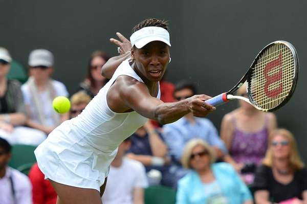 US player Venus Williams plays a shot during