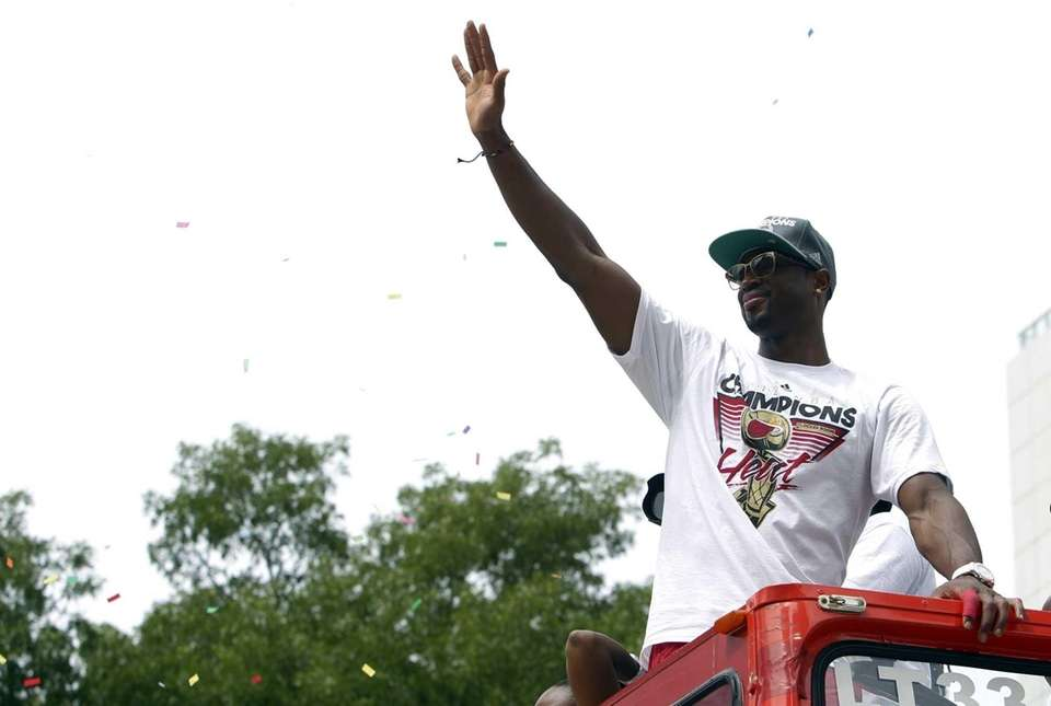Miami Heat's Dwyane Wade waves from a double