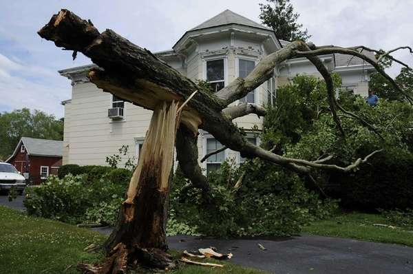 A split tree falls and hits home on