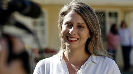 Katie Hill speaks during an interview after voting