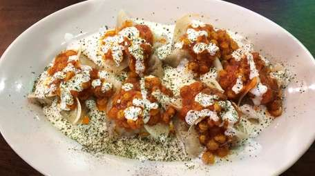 A delectable plate of mantoo--Afghani dumplings here stuffed