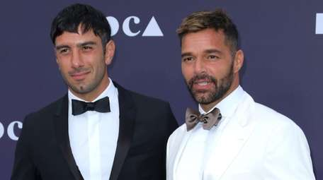 Jwan Yosef, left, and Ricky Martin attend the