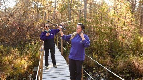 Researchers Casey Prendergast, left, and Samantha Hoff use