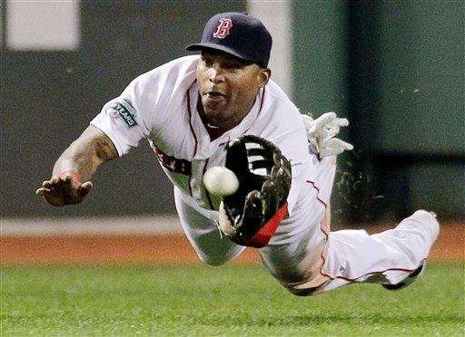 Boston Red Sox center fielder Marlon Byrd dives