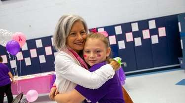 Barbara Wasserman of Massapequa hugs Molly Leary, 10,