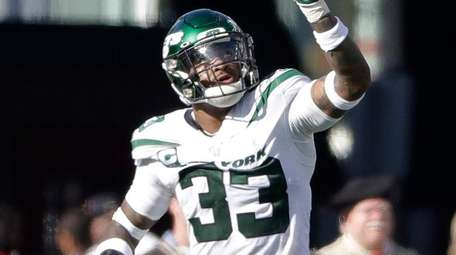 Jets safety Jamal Adams celebrates after he intercepted