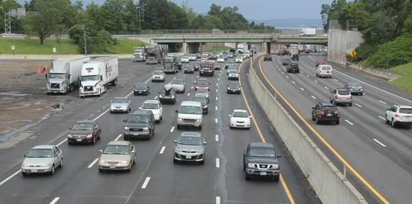 Traffic on I-87 headed westbound, left, from the
