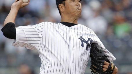 New York Yankees starting pitcher Hiroki Kuroda delivers