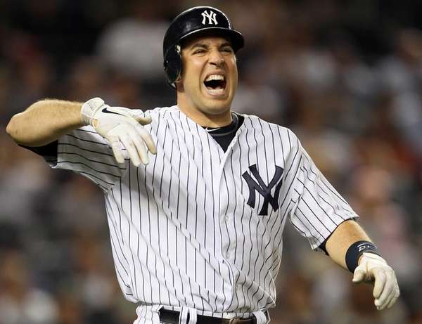 Mark Teixeira reacts after getting hit by a