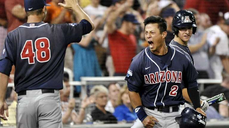 Arizona's Robert Refsnyder (2) celebrates with Konner Wade