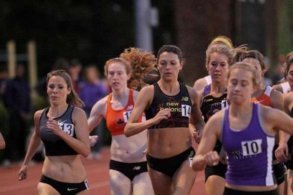 Melissa Salerno, center, number 14, races in the
